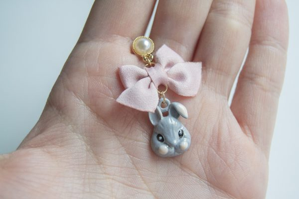 Grey rabbit bow hand