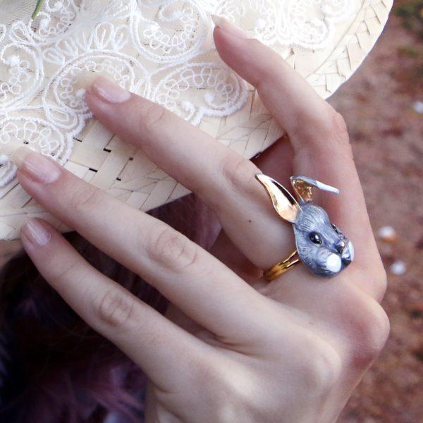 grey rabbit hand